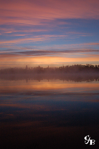 Photo: Sunrise over a brook trout lake in northern Minnesota. Photo by Chris J. Benson