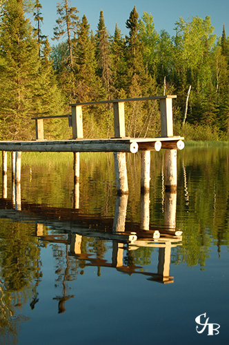 Photo: Dock on a lake in northern Minnesota. Photo by Chris J. Benson